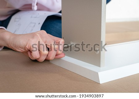 Caucasian woman using screwdriver for assembling furniture BANNER, LONG FORMAT Stock photo © galitskaya