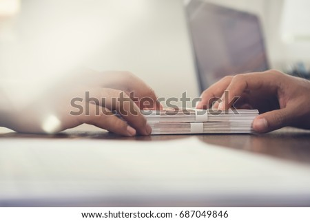 Bribery and corruption, Businessman hand giving money and receiv Stock photo © snowing