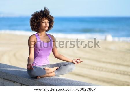 Woman doing yoga Lotus pose oudoors at beach Stock photo © dmitry_rukhlenko