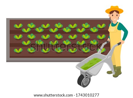 Nő kertész tart talicska fű áll Stock fotó © robuart