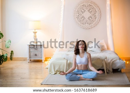 Smiling young brown haired woman in pajamas practicing yoga Stock photo © dashapetrenko