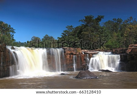 Closeup Of Tropical Tadtone Waterfall In Rain Forest In Chaiyaph Stok fotoğraf © vichie81