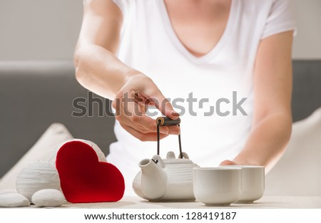 Detail shot of female arm holding tea pot and welcoming to joing Stock photo © HASLOO