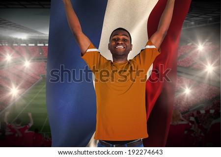 cheering football fan in orange jersey holding netherlands flag stock photo © wavebreak_media