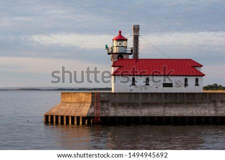 Morning Light Harbor Breakwater Lighthouse Lake Superior Minneso Stock photo © cboswell