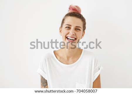 Portrait of smiling girl in white shirt against white wall. Horizontal format. Stock photo © Paha_L