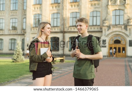 Young smiling female classmates talking outside at the university campus Stock photo © deandrobot