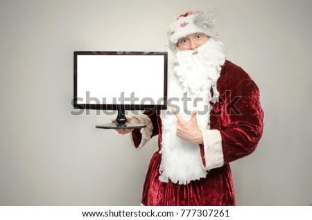 Santa Claus holding blank. Grandfather with a grey beard, fairyt Stock photo © popaukropa
