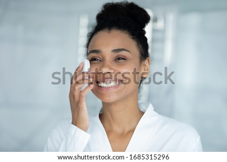 Portrait of gentle young woman with healthy body touching her ne Stock photo © deandrobot