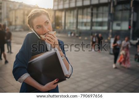 Woman with coffee to go and mobile phone in hand walking down th Stock photo © boggy
