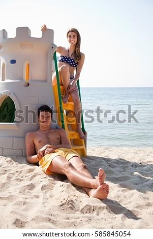 ストックフォト: ビーチ · 女性 · 座って · 砂の城