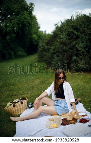 young woman holding picnic basket with bottle of wine and baguet stock photo © dashapetrenko