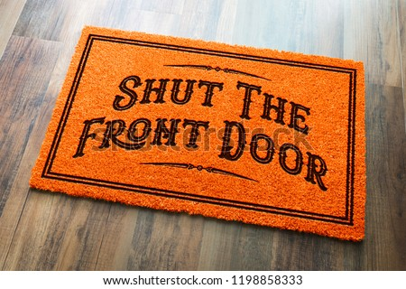 Stock photo: Shut The Front Door Halloween Orange Welcome Mat On Wood Floor B