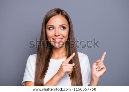 image of two gorgeous women smiling and pointing fingers aside t stock photo © deandrobot