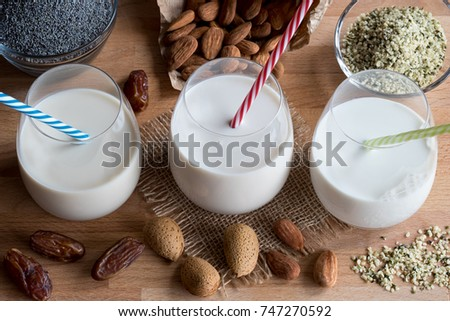 Vegan plant milks - almond milk, poppy seed milk and hemp seed milk Stock photo © madeleine_steinbach