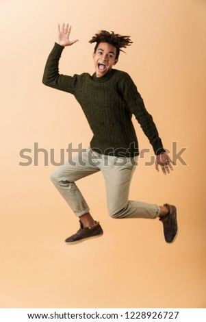 Full length photo of amusing african american guy wearing sweate Stock photo © deandrobot