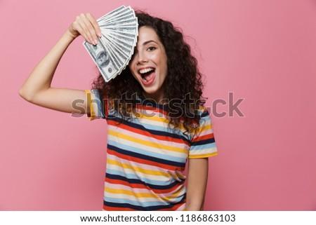 Fotó meglepődött fürtös nő 20-as évek tart Stock fotó © deandrobot