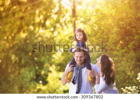 Happy young family spending time together outside in white nature on vacation outdoors. The concept  Stock photo © ElenaBatkova