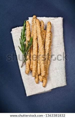 Italian grissini or salted bread sticks on linen napkin on black Stock photo © marylooo