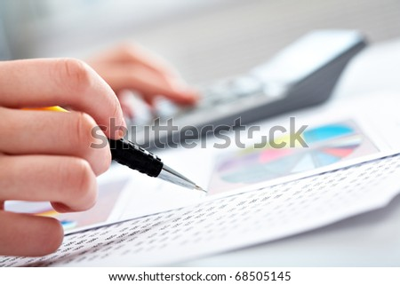 Close up of business pen and white calculator on financial graph Stock photo © Freedomz