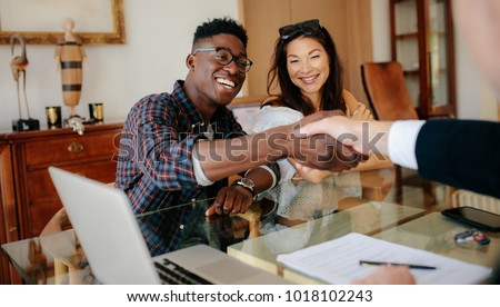 Real estate broker agent and customer shaking hands after signin Stock photo © Freedomz