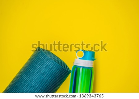 Everything for sports turquoise, blue shades on a yellow background. Yoga mat, sport shoes sportswea Stock photo © galitskaya