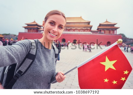 Travel and technology. Young woman tourist with the flag of Malaysia is looking at a city map in a s Stock photo © galitskaya