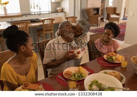 Side view of African American senior woman kissing her husband surrounded by his daughter and his gr Stock photo © wavebreak_media