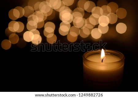 Aromatic candle on golden Christmas and New Years glitter backgr Stock photo © Anneleven