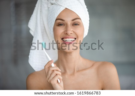 Pretty young healthy woman with toothy smile holding toothbrush Stock photo © pressmaster