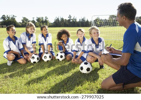 Happy Friends on a Soccer Team. Boys Sports Players Having Fun. Kids Soccer Players Cheering Togethe Stock photo © matimix