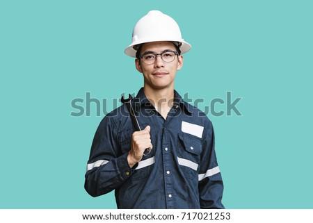 Młody człowiek żółty pracy uniform okulary kask Zdjęcia stock © galitskaya