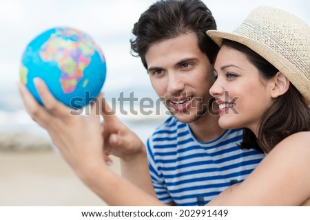 planning their holiday holding up a globe a Stock photo © Lopolo