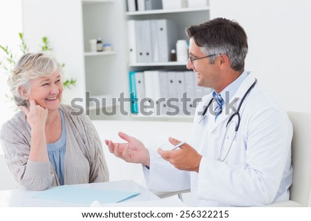 Front view of a male Caucasian doctor examining a senior patient thanks to a stethoscope while he is Stock photo © wavebreak_media