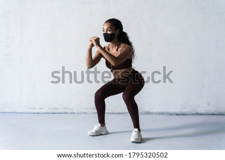 Image of african american sportswoman doing exercise with battle ropes Stock photo © deandrobot