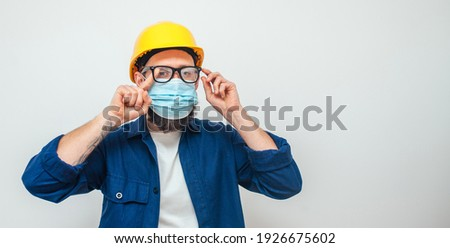 Young male entrepreneur wears disposable medical mask and gloves in metro, prevents coronavirus dise Stock photo © vkstudio