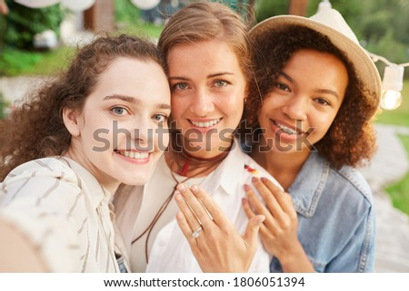 Multi ethnic group of women relax together during summer travel inside the camper van Stock photo © GVS