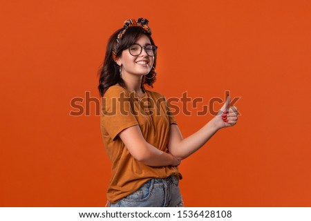 Image of excited caucasian woman in headband expressing surprise Stock photo © deandrobot