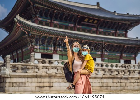 Mom and son tourists in medical mask in Seoul, South Korea. Travel to Korea concept. Traveling with  Stock photo © galitskaya