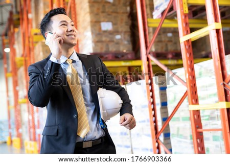Portrait asian businessman making a call in distribution warehou Stock photo © vichie81