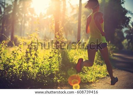 Running woman athlete trail runner - running woman exercising. Fit female sport fitness model traini Stock photo © Maridav