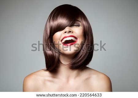 Brown-haired girl with red lips, short bob haircut, face of young pretty woman with light makeup Stock photo © robuart