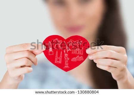 Female holding heart with her arms and famous touristic symbols  Stock photo © HASLOO