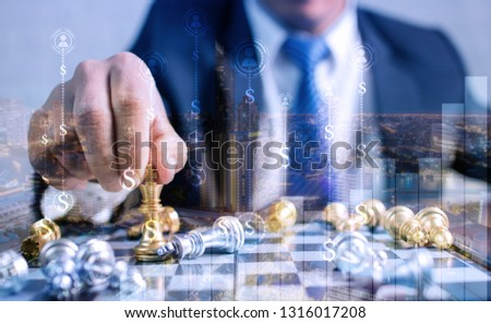 Closeup of a young woman holding chess piece and planning next s stock photo © HASLOO