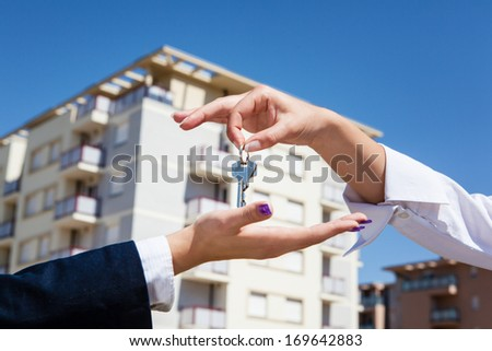 realtor is giving the keys to an apartment to some clients focu stock photo © dacasdo