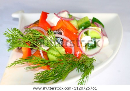 Tasty greek salad with bright vegetables, garnished with basil.  Stock photo © dariazu