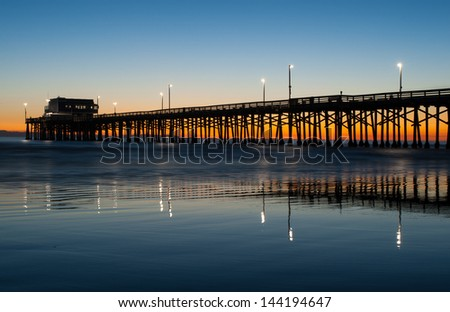 newport beach california pier at sunset in the golden silhouette stock photo © cmcderm1