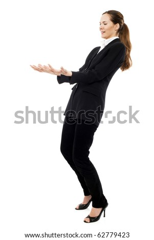 Young businesswoman pretending to carry a weight on white background studio Stock photo © ambro