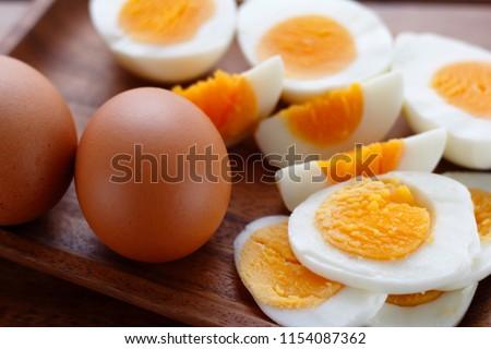 Fresh eggs on wooden plate Stock photo © punsayaporn