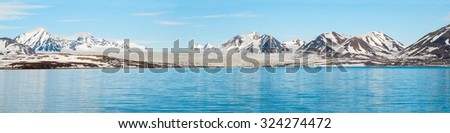 Panorama glaciar mar montanas detrás Foto stock © dinozzaver